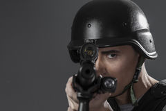 Assault, paintball sport player wearing protective helmet aiming Stock Photos