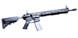 Assault rifle. Semi automatic AR-15 that is isolated on a white background Royalty Free Stock Photos