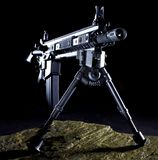 Assault rifle. Semi automatic rifle that is set up with a bipod in the dark on a rock Stock Photography