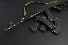 Assault rifle AK-47. With green shoulder strap Royalty Free Stock Photo