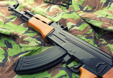 Assault rifle AK-47. Russian assault rifle AK-47 on camouflage clothing Royalty Free Stock Images