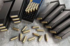 Assault rifle ammunition and loaded clips. Assault rifle ammunition with loaded clips Stock Photo