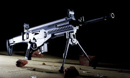 Assault rifle on a bipod. Semi automatic assault rifle in the dark on a bipod Stock Photos