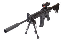 Assault rifle with bipod and silencer Stock Image