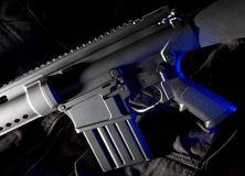 Assault rifle with blue gel royalty free stock photo