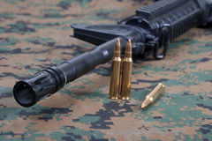 Assault rifle with cartridges Royalty Free Stock Photo