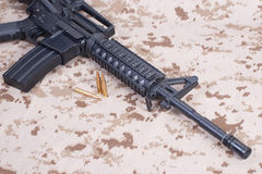 Assault rifle with cartridges on us marines uniform Royalty Free Stock Images