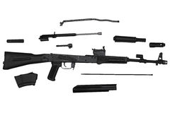 Assault rifle disassembled into parts left side view isolated on white Royalty Free Stock Photo
