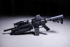 Assault rifle with grenade launcher. Assault automatic rifle with grenade launcher and tactical laser sight royalty free stock photos