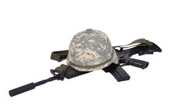 Assault rifle and helmet. On white background Stock Image