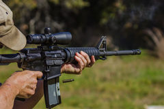 Assault Rifle Live Fire. Shooting weapons at the gun range bullets flying from rifle royalty free stock images