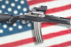 Assault rifle over flag Royalty Free Stock Photos
