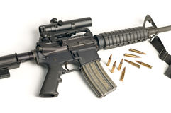 Assault Rifle with Scope & Bullets on White Stock Image