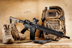 Assault rifle on a wooden table Stock Images