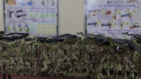Assault Rifles On The Table. Camouflage netting steel arms firearms weapon stock video