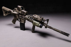 Assault rifre. Assault rifle with camouflage pattern,optical and laser sight Stock Photo
