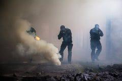 Assault in the smoke stock photos