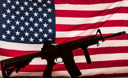 Assault weapon on american flag Royalty Free Stock Images