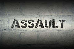 Assault word gr. Assault stencil print on the grunge white brick wall Stock Photo