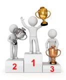 Assegnato con le tazze che vincono trio sul podio. Fotografia Stock
