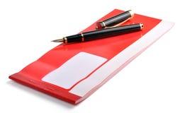 Assegno con la penna Immagine Stock