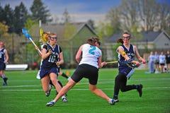 Assegno delle ragazze di Lacrosse Immagini Stock Libere da Diritti