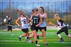 Assegno di Lacrosse attraverso il corpo Fotografie Stock Libere da Diritti