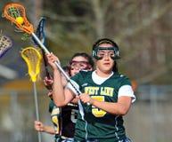 Assegno di Lacrosse da dietro Fotografia Stock Libera da Diritti