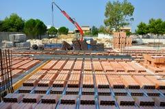 Assemblagevloer in baksteen en cementstructuur Stock Fotografie