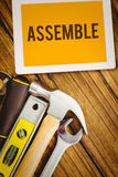 Assemble against desk with tools Royalty Free Stock Images