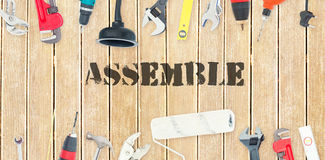 Assemble against diy tools on wooden background Royalty Free Stock Image