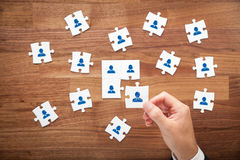 Assemble a team. Cencept. Business team, human resources cooperation, connection and unity concepts. Good team fit together like puzzle pieces stock photos