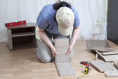 Assemble wooden furniture, woman putting together self assembly Royalty Free Stock Images