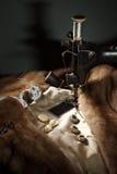 Assemblea del cappotto di pelliccia Immagine Stock