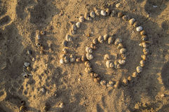 Assembled big shell using a lot of shells on the sand Royalty Free Stock Photos