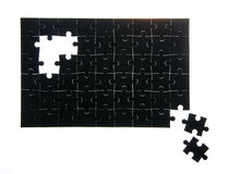 Assembled black puzzle without a few elements Stock Image