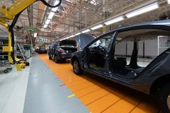 Free Assembled Car Is On The Assembly Line. Robotic Equipment Makes The Assembly Of The Car. Modern Car Assembly At The Royalty Free Stock Photos - 132510728