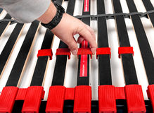 Assembling bed slats for latoflex - Bed frame and mattress base. Surface Royalty Free Stock Image