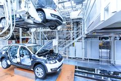 Assembling cars on conveyor line Royalty Free Stock Photos