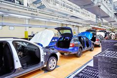 Assembling cars on conveyor line Stock Photo