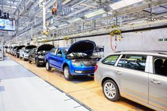 Assembling cars on conveyor line Royalty Free Stock Photo
