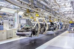 Assembling cars on conveyor line Royalty Free Stock Photography