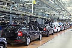 Assembling cars Skoda Octavia on conveyor line Royalty Free Stock Photo