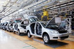 Assembling cars Skoda Octavia on conveyor line Royalty Free Stock Images