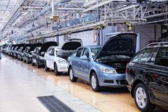 Assembling cars Skoda Octavia on conveyor line royalty free stock photos