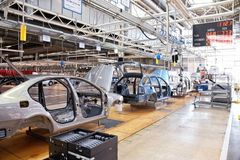 Assembling cars Skoda Octavia on conveyor line Stock Photography
