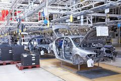 Assembling cars Skoda Octavia on conveyor line Royalty Free Stock Photography