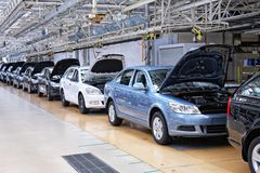Assembling cars Skoda Octavia on conveyor line Stock Photo