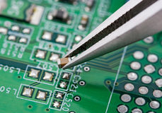 Assembling a circuit board stock photos