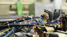 Harnesses of electrical cables lie on the circuit board. Assembling the control system of a modern CNC machine. Harnesses of electrical cables lie on the stock footage